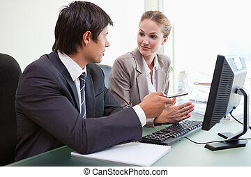 Business team working with a computer