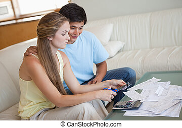 Young couple cutting their credit card
