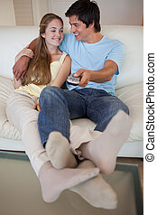 Portrait of a lovely couple watching television