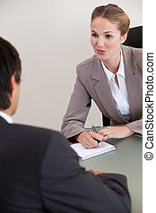 Portrait of a serious manager interviewing a male applicant