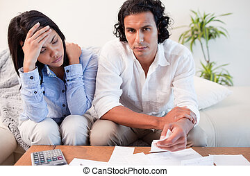 Couple experiencing financial problems - Young couple...