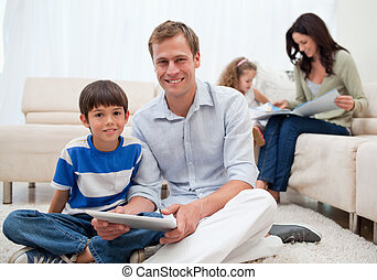 Family spending free time in the living room - Young family...