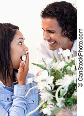 Woman is surprised by the bouquet she got from her boyfriend