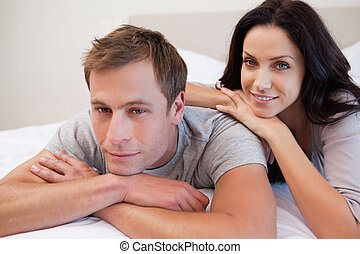 Couple relaxing in the bedroom together
