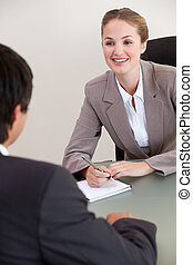 Portrait of a smiling manager interviewing a male applicant