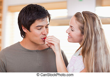 Man tasting the meal of her fiance