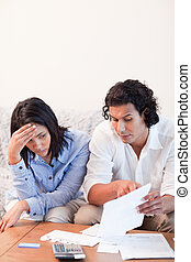 Couple talking about bad news they got by mail