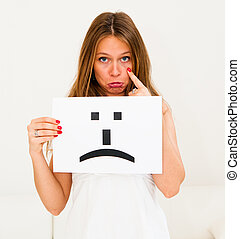 sad emoticon face sign - portrait young woman with board sad...