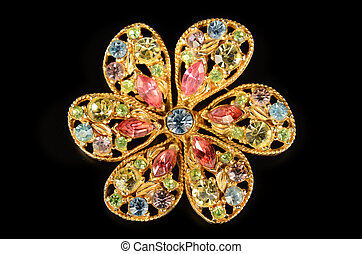 Gem Brooch - Colorful gem brooch on black background