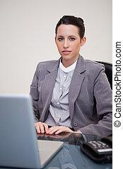 Businesswoman sitting behind desk