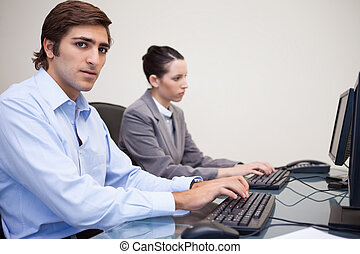 Side view of business people working next to each other