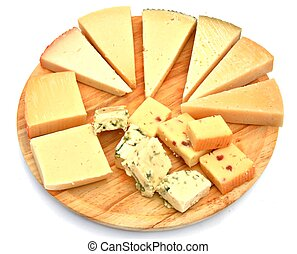 Assorted cheeses on wooden table, surrounded by white...