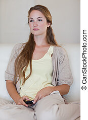 Woman with cellphone in thoughts