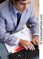 Above view of businessman typing - Above view of young...