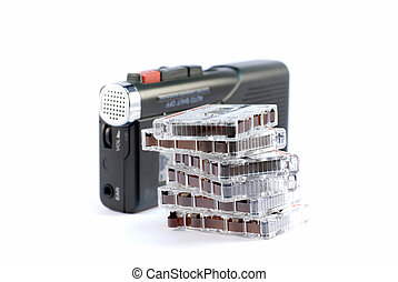 Dictaphone on white backgrounds with a stack of records