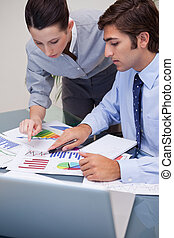 Business team working on sales statistic