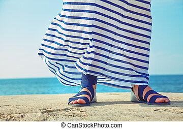 female feet in billowing dress