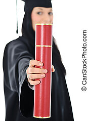 Student girl in an academic gown, graduating and diploma