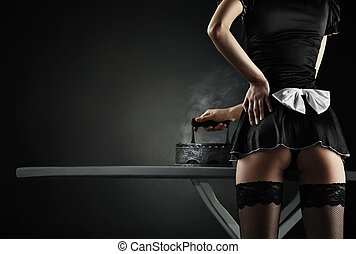 Vintage sexy maid with retro iron on black background
