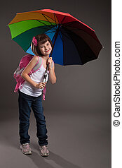 Portrait of a cute small girl going to school. Studio shot
