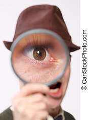 Curious man with magnifying glass.