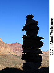 rock cairn silhouette along the Tonto Trail in the Grand...