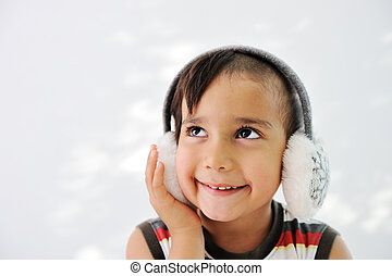 Kid with headset on ears for winter