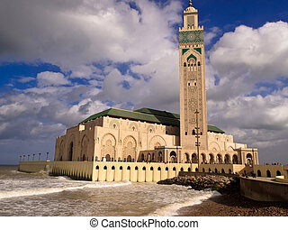View of Hassan II Mosque and Minaret in Casablanca, Morocco with crashing waves
