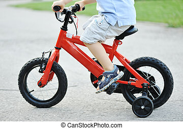 Kid  riding cycle