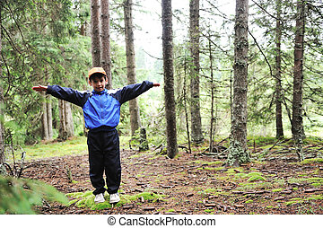 Kid in forest