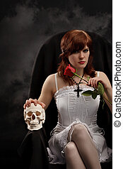 Young sexy witch with a skull and rose - Young sexy witch...