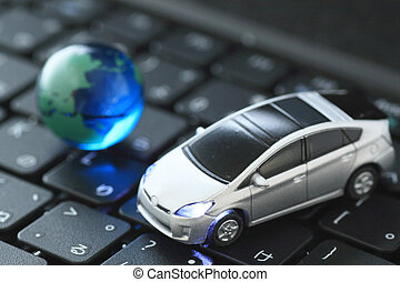 Glass globe and car over keyb - Glass globe and toy car over...