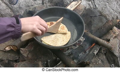 Campfire Quesadillas. - Cooking quesadillas on a campfire.