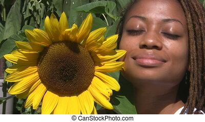 Girl with sunflower.