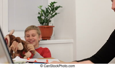Funny kids - Business woman working in the office and at the...