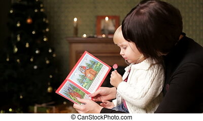 Christmas Tale - Woman reading a Christmas story of her...