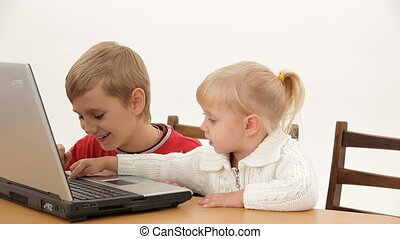 Children play on the computer - Two small children...