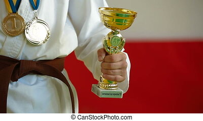 I won - boy receive karate trophy and medal for the victory