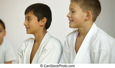 Karate Kids - two children during training Karate in the gym