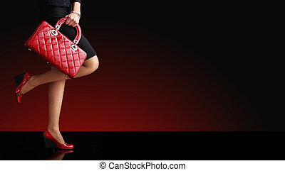 Woman sexy legs with handbag. Shopping and business