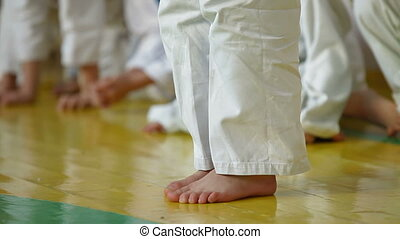 Karate Kid - preschooler during training Karate in the gym