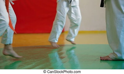 Karate Student Practicing - coach at the gym teaches...