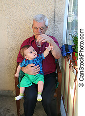 happy family portrait - Grand father and grand son playing...