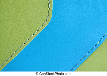 Natural green and blue leather background closeup