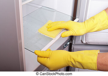 Hands cleaning refrigerator