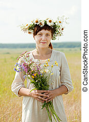woman in camomile chaplet - Outdoor portrait of woman in...