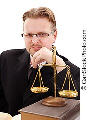 Serious attorney with golden scale