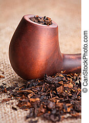 Smoking pipe and tobacco - Macro of smoking pipe and tobacco...
