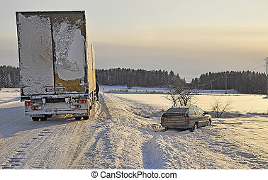 Car crash at snow road in winter