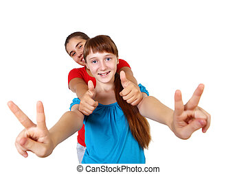 two teenage girls together in studio against white...